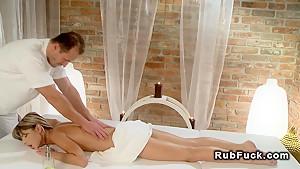 Petite brunette enoying in erotic massage