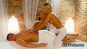 Blonde masseuse massages hard dick and fuck