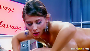 Busty tanned brunette Madison Ivy gives Toni Ribas a massage