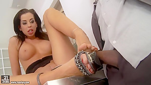 Larissa Dee caresses her black boyfriend's XXL cock with her sexy feet
