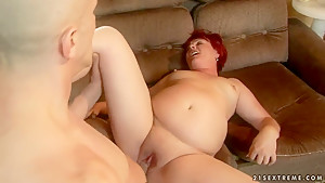 Redhead granny feels fat penis entering cunt