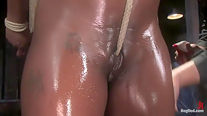 Jada Fire is back, oiled up, bound and made to squirt.