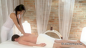 Beautiful brunette masseuse fucks handsome guy