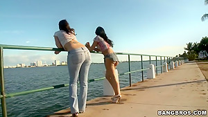 Kinky pornstars showing bug asses outdoors
