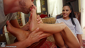 Teen brunette, Apolonia Lapiedra is using her soft feet to give a hard- on to her guy