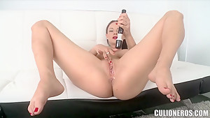Curvy sex-bomb with big boobs Abbie Cat plays with a toy on the camera