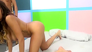 Blonde and brunette nymphos sharing a vibrator and a cock on the bed