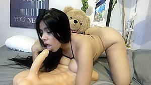 Lucy puts condom on dildo blowjob