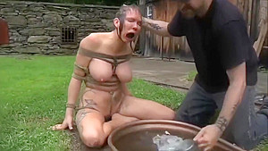 Sexy harlot performing in BDSM video